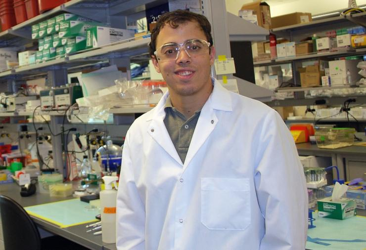 Robert Mannino standing in the lab with equipment in the background